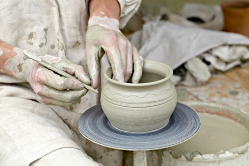 Potter's hands making a pot in traditional style