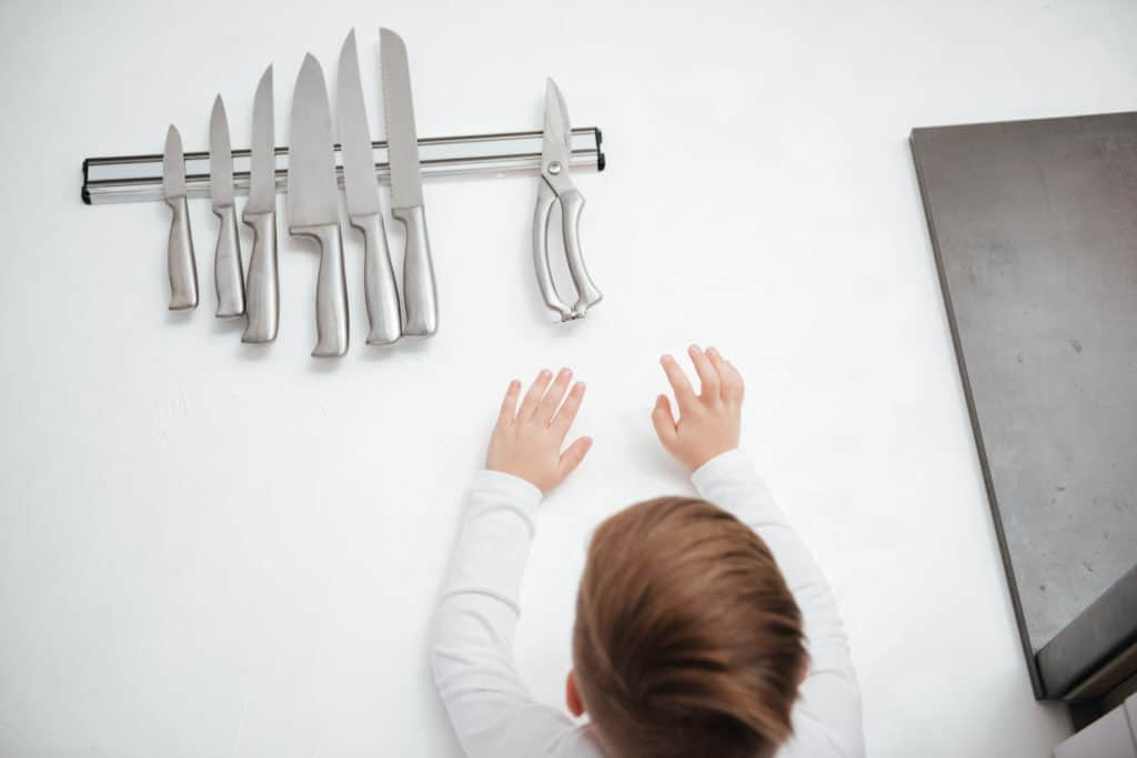 Child reaching for knife!