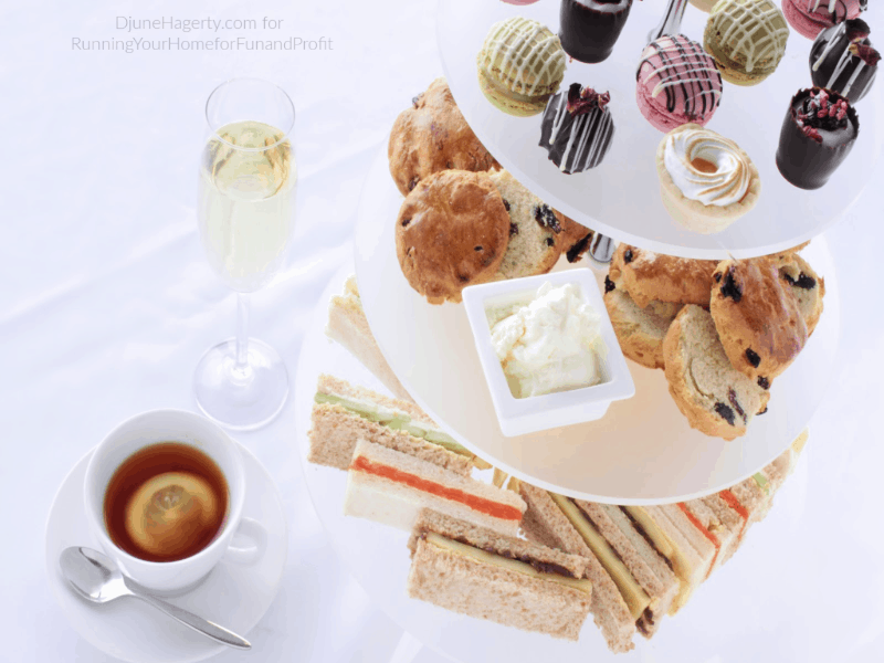 Tea, scones, cookies, and finger sandwiches arranged for serving