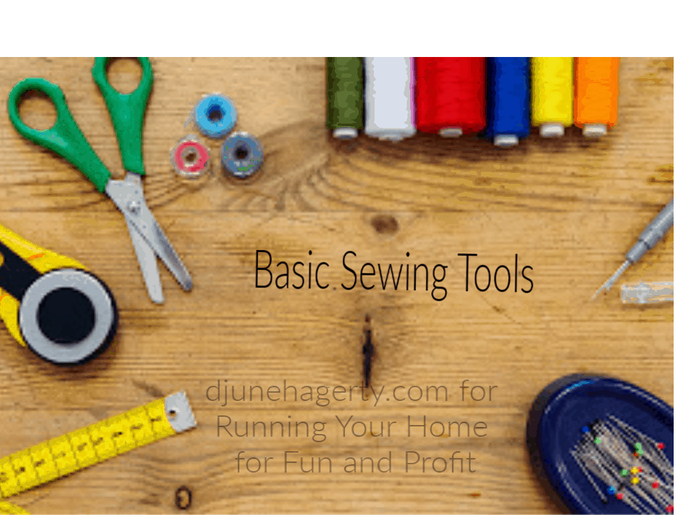A picture of basic sewing tools, including scissors, threads, a rotary cutter, a tape measure and pins.