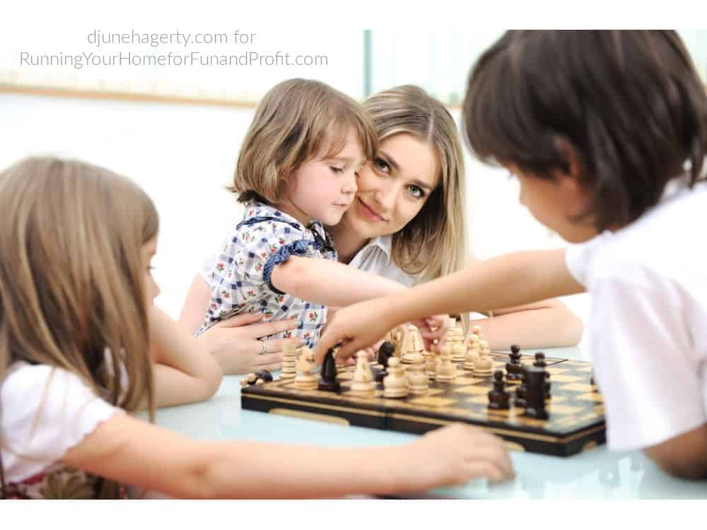 Mother and children at chess board