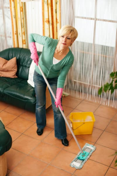 Homemaker cleans floor carefully
